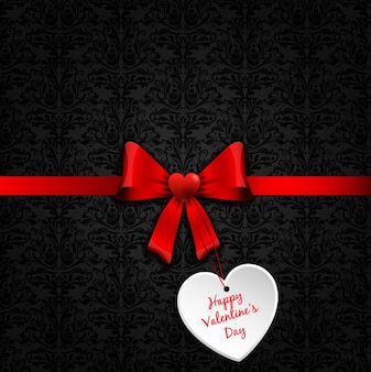 Red bow with a valentine day tag