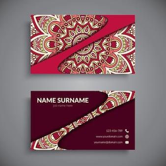 Red business card with a mandala