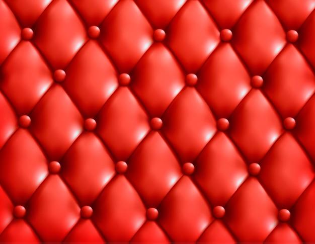赤いボタン房状の革の背景。