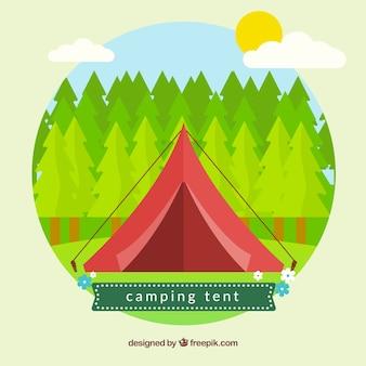 소나무 배경으로 빨간 캠핑 텐트