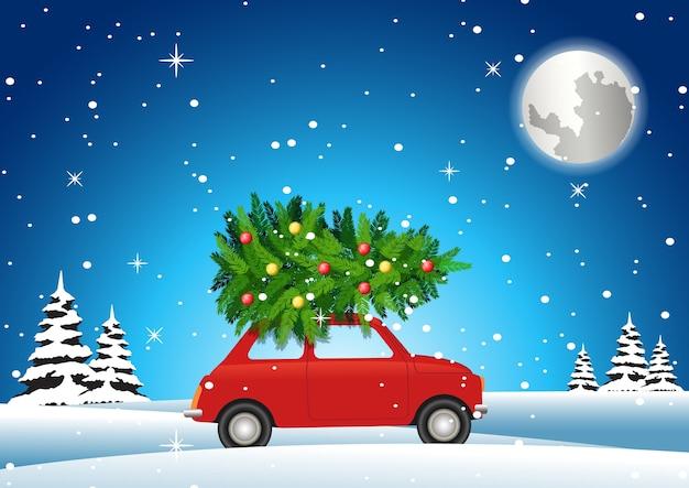 赤い車は大きな休日を飾るためにクリスマスツリーを運ぶ