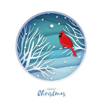 Красный кардинал сидит на ветке. поздравительная открытка с рождеством.