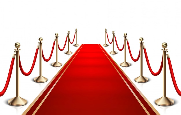 Red carpet and gold barrier.