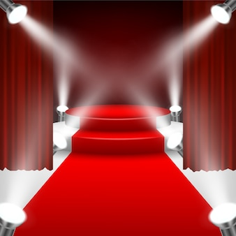 Red carpet to podium stage with spotlights and red curtain