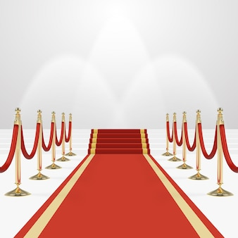 Red carpet on stairs to empty white illuminated podium