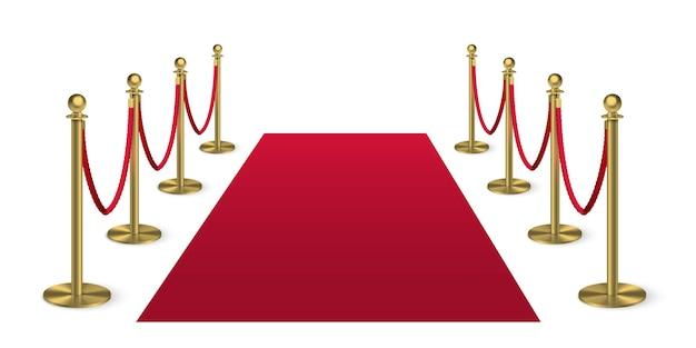 白い背景のエンターテイメントフェスティバルイベントの報酬式で隔離の金色の柱のガードとレッドカーペット