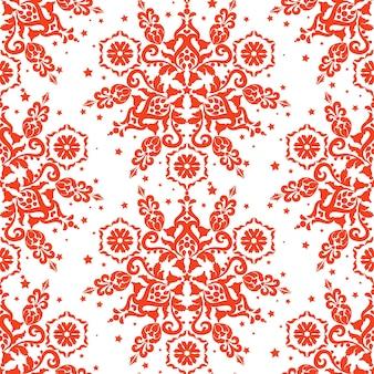赤いクリスマスの背景白い背景の上の赤い飾りシームレスなベクトルパターン生地の