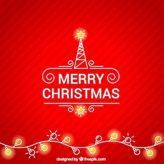 赤いクリスマスの背景にクリスマスライト