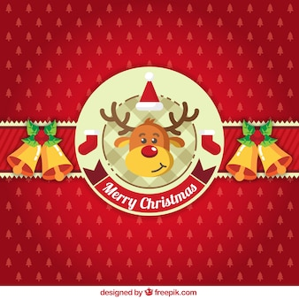 Red christmas background with ornaments and a reindeer