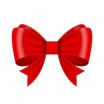 白い背景で隔離の赤いクリスマスの弓