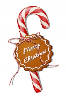 Red christmas candy cane with red striped ribbon and cookie with merry christmas text.