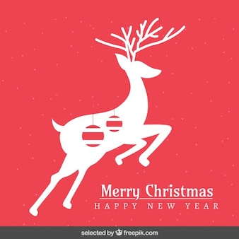 Red christmas card with deer silhouette