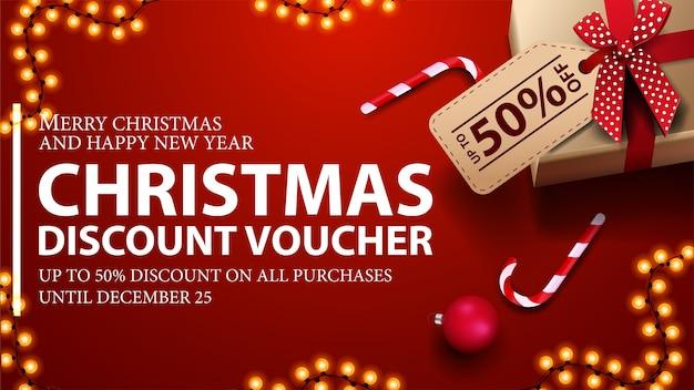 値札、キャンディケインと花輪フレーム、上面図のプレゼントと赤いクリスマス割引券