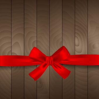 Red christmas ribbon on wooden background