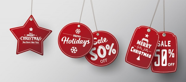Red christmas sale paper tags set with different shapes.
