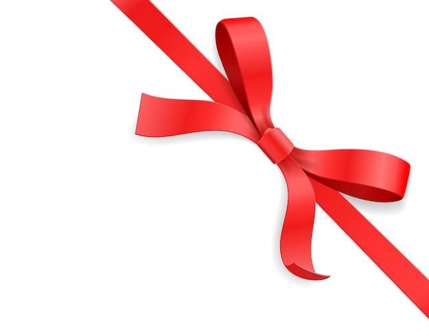 赤い色のサテンの弓の結び目と白い背景の上のリボン。お誕生日おめでとう、クリスマス、新年、結婚式、バレンタインの日ギフトカードまたはボックスパッケージのコンセプト。クローズアップイラストトップビュー
