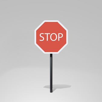 Red color stop road sign on white