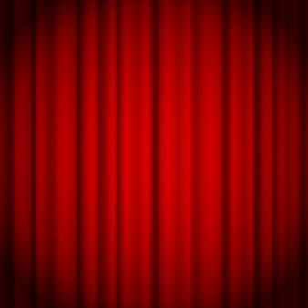 Red curtains background illuminated by a beam of spotlight.