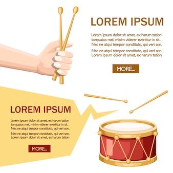 Red drum and wooden drum sticks. hand hold drumsticks.