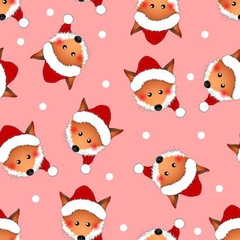 ピンクのクリスマスの背景にレッドフォックスサンタクロース