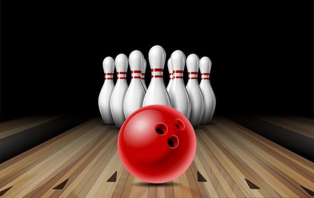 ボウリング場のライン上を赤い光沢のあるボールが10個まで転がり、白いボウリングピンが順番に配置されます。コンセプトスポーツ競技またはアクティビティと楽しいゲーム。