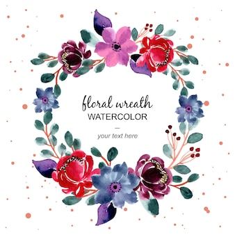 Red and green floral watercolor wreath