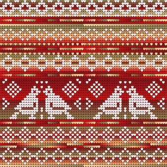 赤緑のグラデーションの色冬の鳥とクリスマス編みのシームレスなパターン