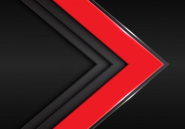 暗い空白スペースの背景に赤灰色の矢印の方向。