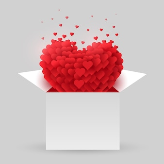 開いた箱の中の赤いハート。バレンタインデー。