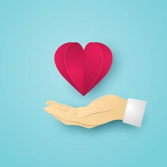 인간의 손에 붉은 심장