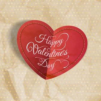Красное сердце на винтажной бумаге с copyspace.
