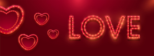 Red heart shapes decorated with marquee lights