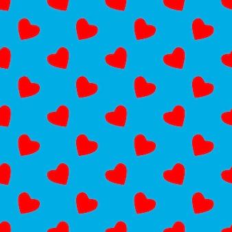 赤いハートのシームレスなパターン。ベクトルイラスト