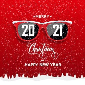 降雪の背景に赤い流行に敏感なメガネ。明けましておめでとうとメリークリスマスの風景。