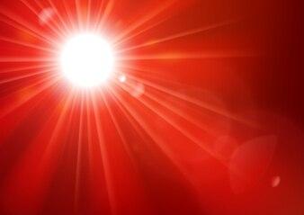 レンズフレアの背景で輝く赤い光