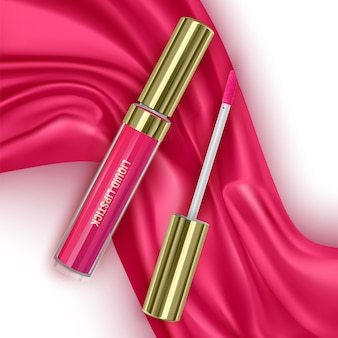 Red lipstick on bright pink silk or velvet fabric background cosmetic open tubes makeup