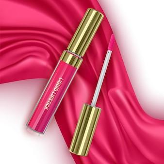 밝은 분홍색 실크 또는 벨벳 패브릭 배경 화장품 오픈 튜브 메이크업에 빨간 립스틱