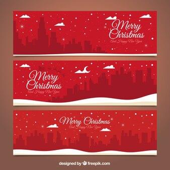 Красные веселые рождественские баннеры с городской пейзаж