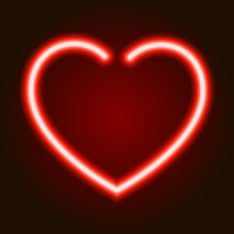 Red neon glowing heart symbol of love on dark background of