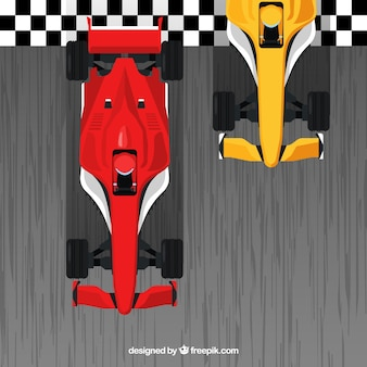 Red and orange f1 racing cars crossing finish line