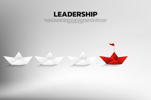 Red origami paper ship leading the group of white.