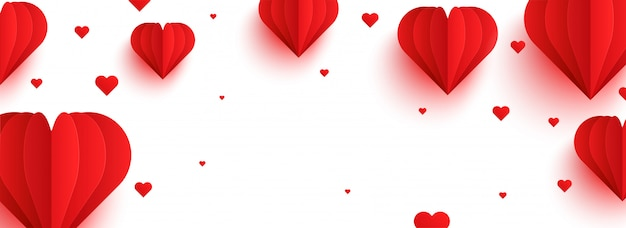 Red paper hearts on white background
