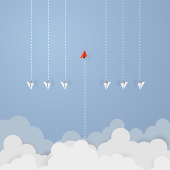 Red paper leader airplane flying on blue sky of business