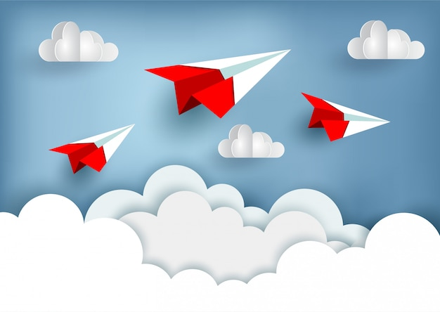 Red paper plane up to the sky while flying above a cloud