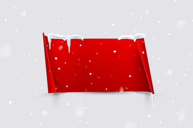 降雪の背景に分離されたカールしたエッジを持つ赤い紙シート。