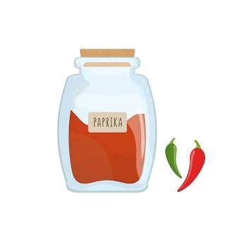 分離された透明なガラス瓶に保存された赤いパプリカ粉末