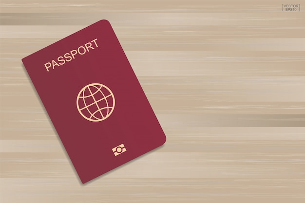 Red passport on wood pattern and texture background.