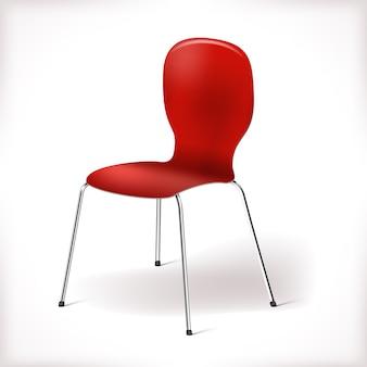 分離された赤いプラスチック製の椅子
