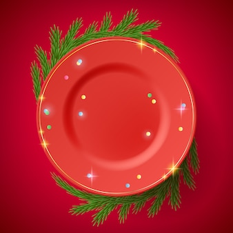 Red plate on the table decorated with branches