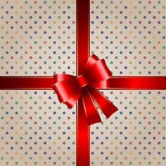 Fiocco regalo con nastro rosso con sfondo vintage a pois